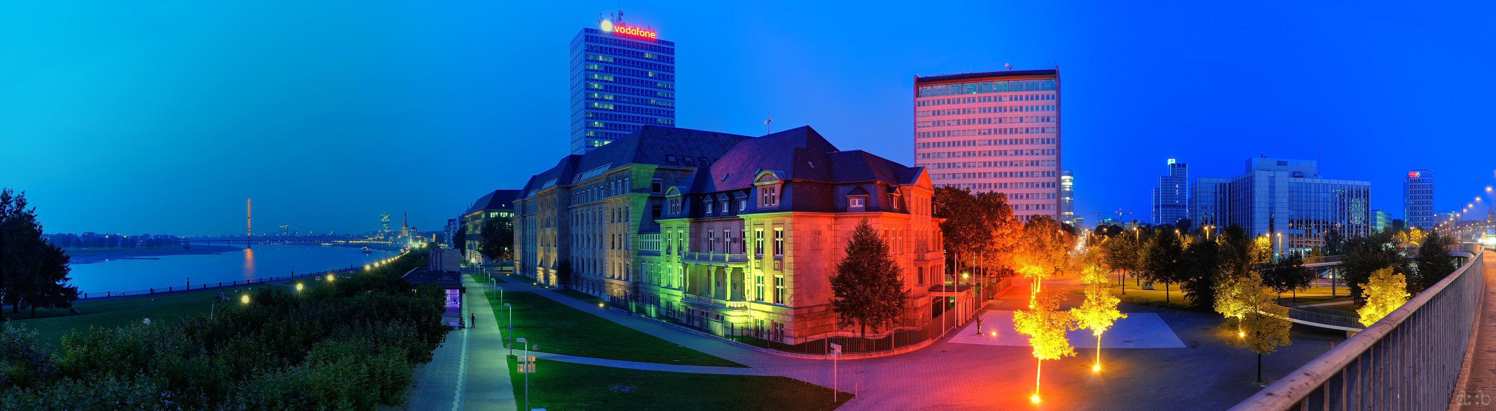 """Panorama of Düsseldorf's old town around the Rhine-side, colorfully illuminated in the """"blue hour"""":"""