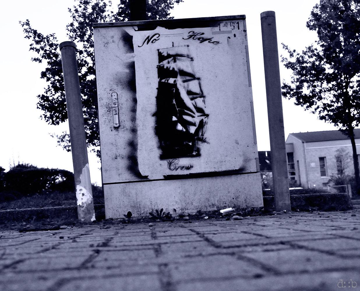 "A graffiti reads ""no hope crew""."