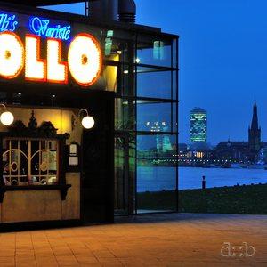 """Apollo"" varieté in Düsseldorf at night, during a winter flood."