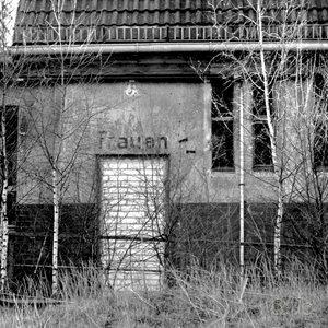 """A former door, labeled """"women"""", has been bricked at station Siemensstadt-Fürstenbrunn in Berlin."""
