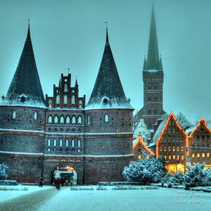 The Holstentor, landmark to the city of Lübeck, on a deeply cold winter's eve.