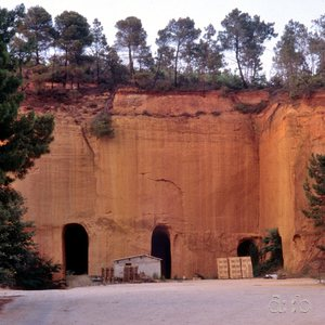 Caves in an ochre rock at Roussillon, southern France, in 1988.