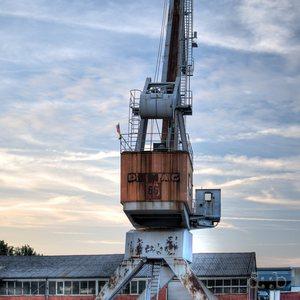 A vintage Demag brand crane in Düsseldorf's harbor.