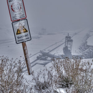 A sign warns from falling down the slope at one of Germany's most notorious lignite mines