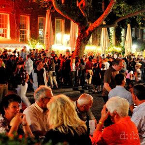 Typical Altbier night scene in Düsseldorf's old town.