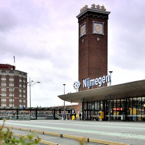 Nijmegen central station's foreground, surrounded by the station tower and another one, being a very welcoming hotel