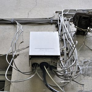 Telephone and Internet lines, arbritraily interconnected and confused in a Berlin city backyard
