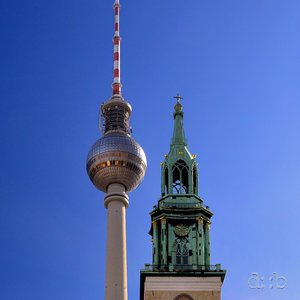 (Former East) Berlin's television Tower, overtopping a historic curch next to it