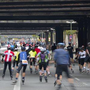 Berlin roller blade marathon contestants passing under a set of railway bridges