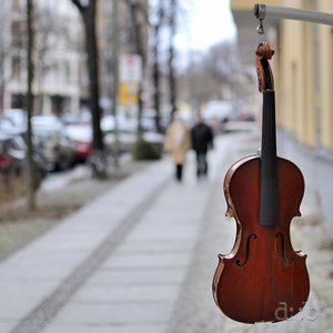 A violin hanging out on the streer