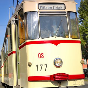 "A historic tramway rides as line 13 to the ""Unification place"" (""Platz der Einheit"")"