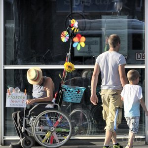 A handicapped guy, earning some extra money by collecting returnables