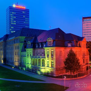 "Panorama of Düsseldorf's old town around the Rhine-side, colorfully illuminated in the ""blue hour"":"