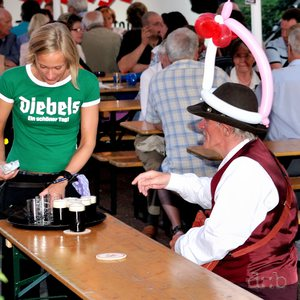 Rhineland Schützenkirmes: A fancy-dressed gentleman is being served fresh Altbier.