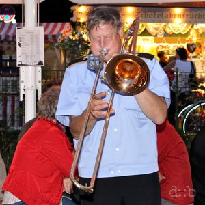 A trombone player performing an after-hour solo session at a Schützenfest.