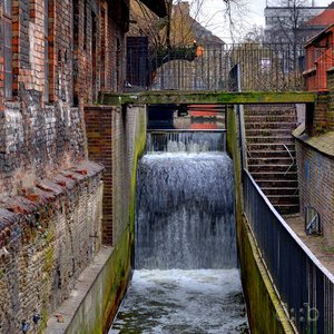 The old millstream next to the mill building in the center of Gdansk