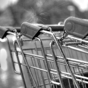 Shopping carts on a grey, rainy night.