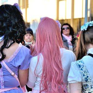 Cos-playing girls enjoying public attention.