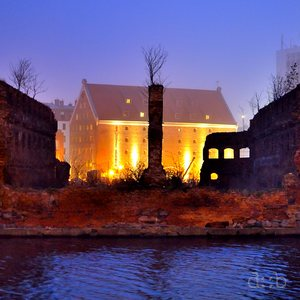 Ruins of a storage building in Gdansk's old port, illuminated like a Halloween pumpkin.