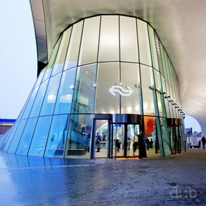 The upper rear portal of Arnhem central station, illuminated on a rainy day