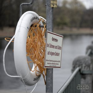A lifebelt, somehow ready to save lives from being lost in the river Spree