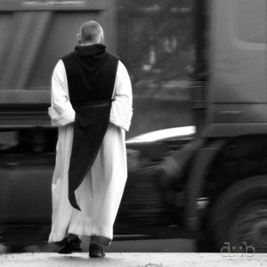 A cistercian munk taking a walk along the national road in front of the Langwaden monastery