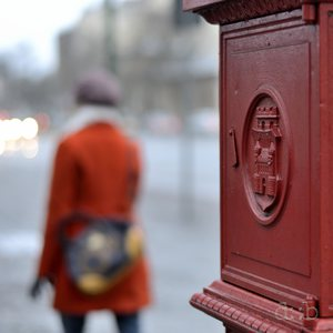 A fire post and a lady, both in red