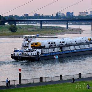 Cargo vans are shipped on the Rhine near Düsseldorf.