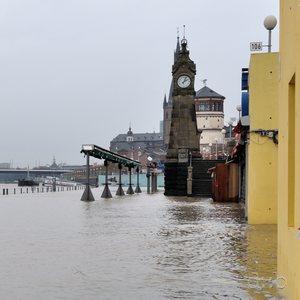 Düsseldorf's central Rhine promenade during and under a winter flood.