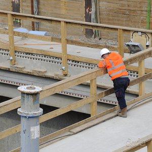 A construction worker looking at the progress of Berlin metro line U5 near Alexanderplatz.