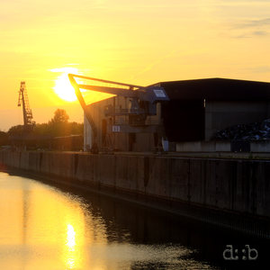 The setting sun reflects in the bassins of Düsseldorf's container port.