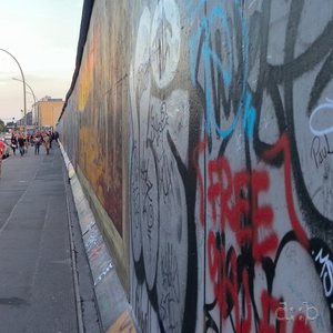 Panoramic view of a Berlin essence: Mercedes, commerce, dominating cars, pet cremation and of course the wall